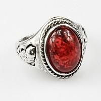 925-s ezüstözött gyűrű, sötét borostyán kővel
