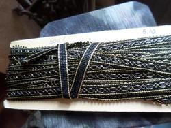 Fekete-arany szegőszalag . Kb 5 méter x 1,5 cm