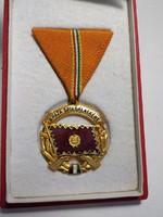 Szocreál kitüntetés a haza szolgálatáért