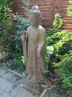 Hatalmas, valódi kő Buddha szobor. Keleti, Kínai.