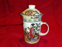 Porcelán teás csésze ,teafű szűrővel, fedővel,gyönyörű jelenetes díszítéssel.