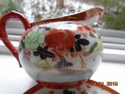 Kutani japán aranykontúrozott kiöntő pünkösdi rózsás,madaras,gésával,vaspiros alapon arany jelzés