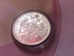 1886 ezüst 1 florin,verdefényes aUNC kapszulában,így nagyon ritka!!