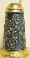 Kézzel domborított ,mitológiai jelenetes korsó