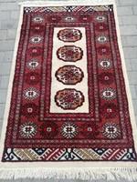 Pakisztáni Bokhara kézi csomózású szőnyeg.122x79cm