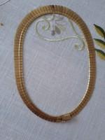 Arany nyakèk 18 karátos nem rikitó sárga nagyon szép szine van.