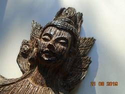 Faragott fa Buddha szobor fém talpon-46 cm