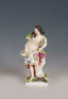 Papagájt tartó női porcelánfigura