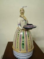 Kerámia gyertya tartó női alakos.Kézzel festve színes máz. L-8