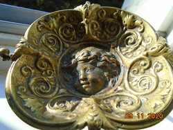 19 Sz Rococo with plastic putto, fire-gilded bronze wine tasting bowl, with decorative tongs, on goat legs