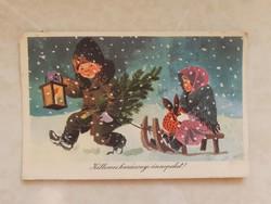 Régi karácsonyi képeslap szánkózás este hóesésben