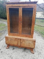 Beautifully shaped antique display cabinet with small ball print