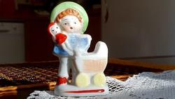 Aranyos, picike, régi, kis babakocsis porcelán kislány figura.