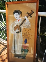 Chinese woman playing musical instrument
