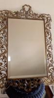 Florentin stílusú keretben csiszolt tükör.