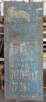 Vintage dairy hall cooperative entrance advertising door painted with angelic coat of arms