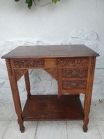 Rustic table with two drawers, openable top with oak carved decoration