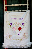 Beautiful, linen, hand-embroidered decorative towel with lacy edges