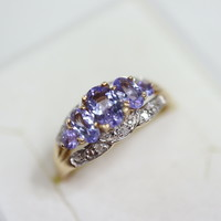 Gold ring with tanzanite and diamond stones 14 kr.