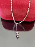 Különleges, kecses ezüst nyaklánc függővel díszítve