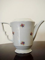 Old zsolnay porcelain teapot with floral tea pouring