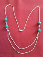Showy jewelry chain with green beads