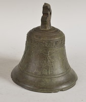 Old bronze bell with religious scene