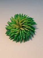 Plastic green brooch