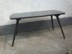 Retro black coffee table, usable but in need of renovation
