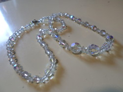 Fine necklace made of 54 cm faceted crystal beads with luster.
