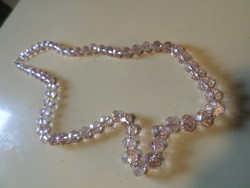 60 Cm necklace of light pink, faceted crystals.