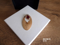 Gold-plated pendant with red and white stones