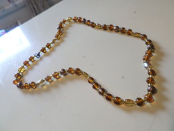 63 cm necklace made of amber and honey colored glass beads.