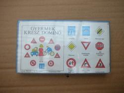 Kids cross dominoes