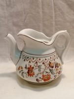 Antique porcelain spout
