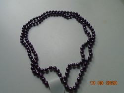 Long necklace made of hand-crocheted purple beads