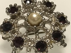 Silver-plated brooch with garnet-colored crystals, 3.5 cm in diameter