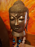 Old oriental copper buddha head on iron stand at casual price