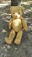 Antique large straw teddy bear with hard wood soles