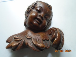 19.Hand carved wooden putto bust