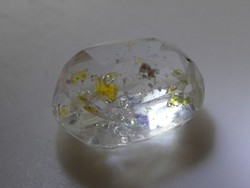 Polished rhinestone faceted gemstone made of natural hydrocarbon-enclosed quartz. 3.25 Ct.