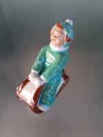 Retro ceramic sledding little girl figurine